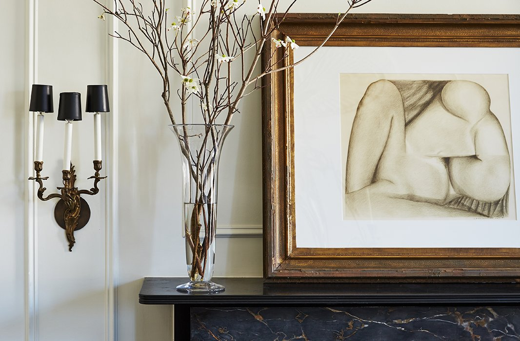 "An abstract is placed above one of the home's many mantels. ""Some of my art is precious, some of it found,"" Darryl says, ""but each is very evocative to me on a very personal note. Some of the pieces serve almost as a Rorschach test in regards to my guests."""
