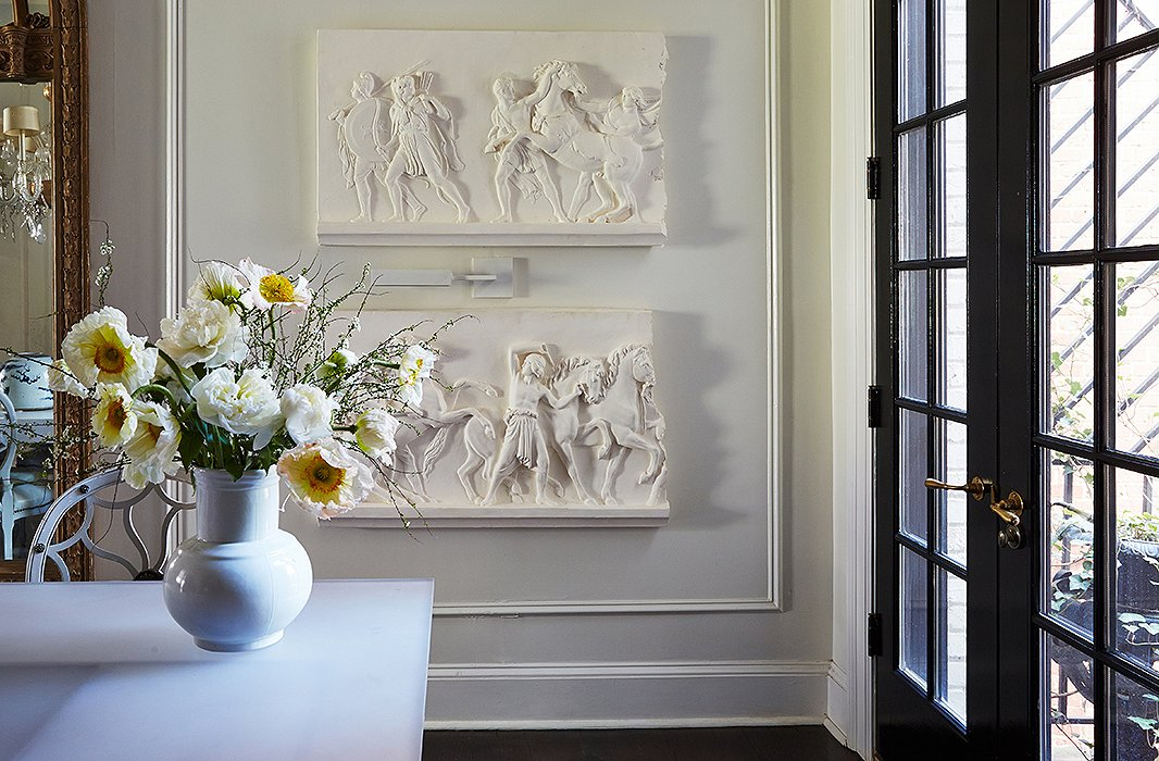 "Known for his studied eye for art, antiques, and artifacts, Darryl commissioned a local plasterer to recreate these cast friezes inspired by the painting Entry of Alexander into Babylon. ""To be clear, I would never place art as a decoration in a room. I would far more be prone to design a room around the art."""