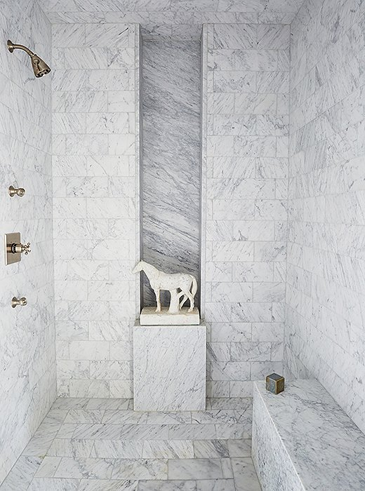 "Darryl's design for the master bath is streamlined and elegant—but not without intrigue. ""I have a fascination with horses. I think they are beautiful creatures,"" he says. ""I also have an incredible capacity to shop from a moving car, and I actually saw this horse from a window of my car in traffic."""