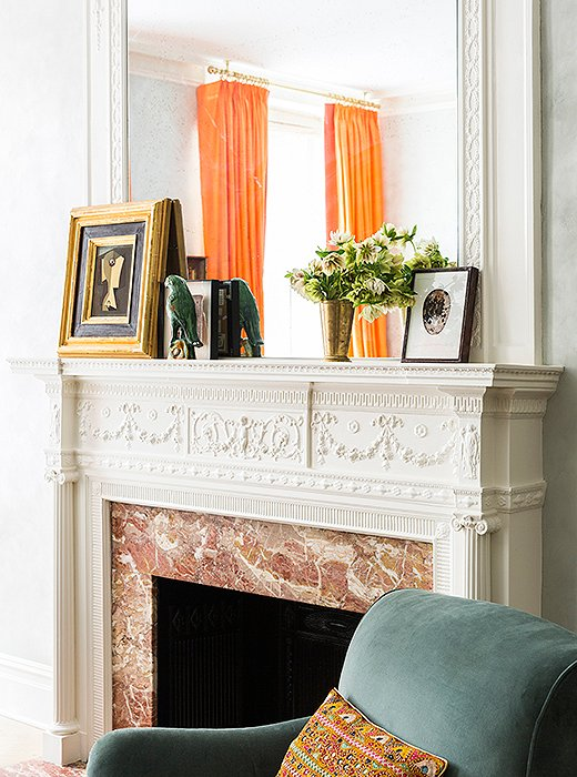 Color is a constant in Roberta's Upper West Side apartment. Case in point: A glimpse of vibrant silk curtains (one of several sets Roberta unearthed at a Bangkok market) enlivens a neutral vignette atop the living room mantel.