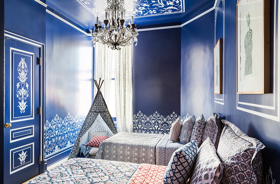 "The guest bedroom is the home's one ""totally Roller Rabbit room,"" Roberta says. From the sheets to the pillows to the fabric tepee, every textile boasts the brand's signature block prints. Even the walls get in on the pattern play, decked out in a hand-stenciled design (courtesy of Roberta's sister) modeled after a palace Roberta visited in India."