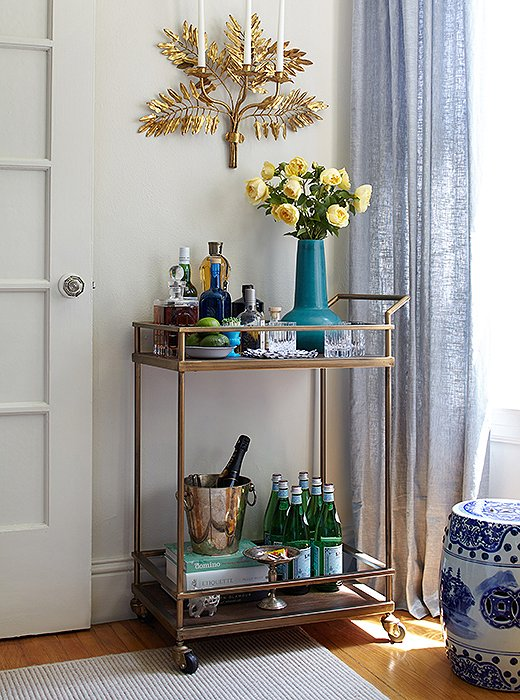 On her bar cart, Stacie stocks the essentials: citrus, spirits, champagne, and Pellegrino.