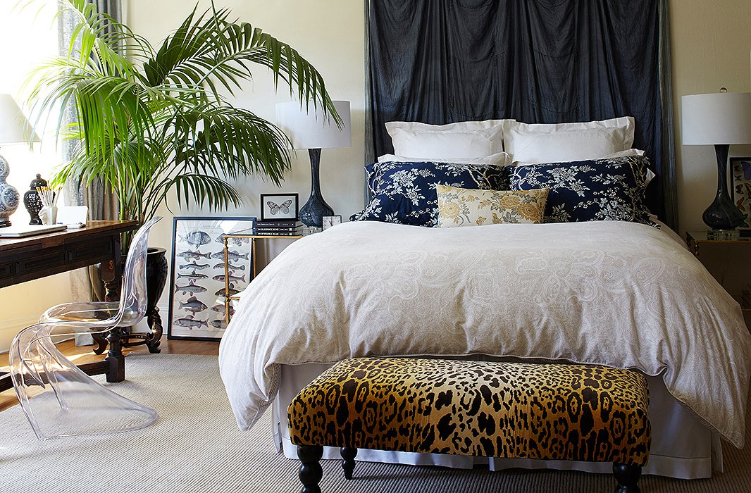 The leopard-print bench at the foot of Stacie's bed acts as a daily place to put on shoes and can moonlight as dining room seating when she's entertaining.