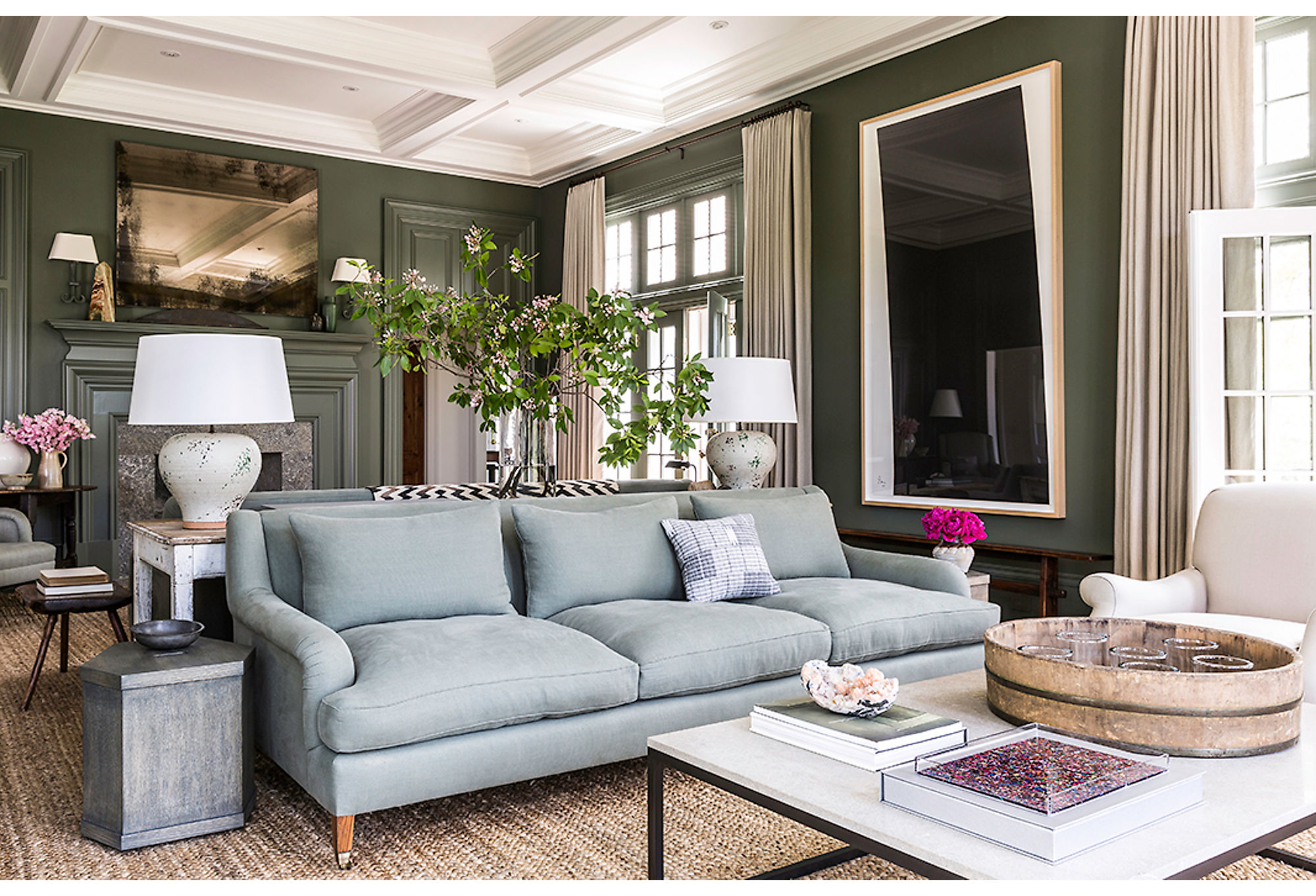 Designer Mark Cunningham created two distinct zones in this Connecticut home by placing sofas back-to-back to define separate sitting areas. Photo by Lesley Unruh.