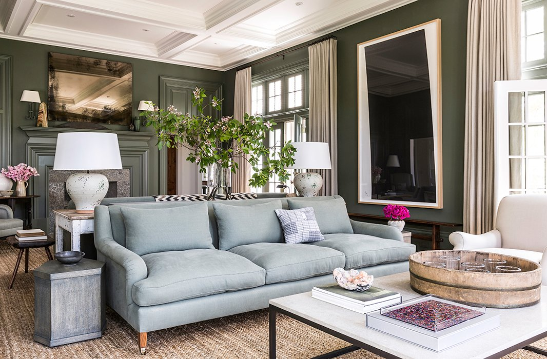 """Bretttells us her expansive living room—which boasts dueling sofas—is her favorite: """"The ceilings are high. There are windows and doors all around. I love every piece of furniture in it, and it's just so comfortable."""""""
