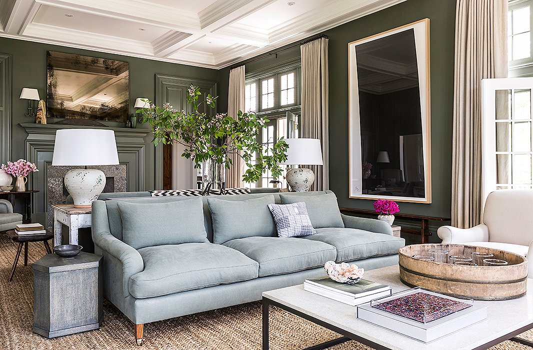 "Brett tells us her expansive living room—which boasts dueling sofas—is her favorite: ""The ceilings are high. There are windows and doors all around. I love every piece of furniture in it, and it's just so comfortable."" The Brooke sofa is similar in style. Find a similar coffee table here."