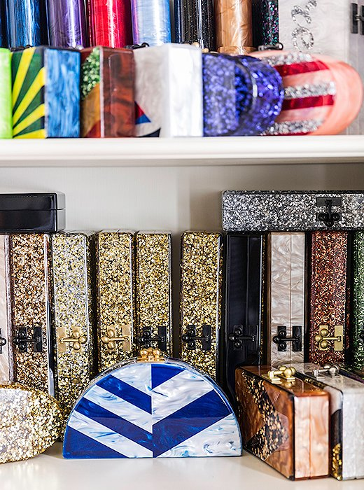 Bookshelves store archives of Edie Parker's sparkly box clutches.
