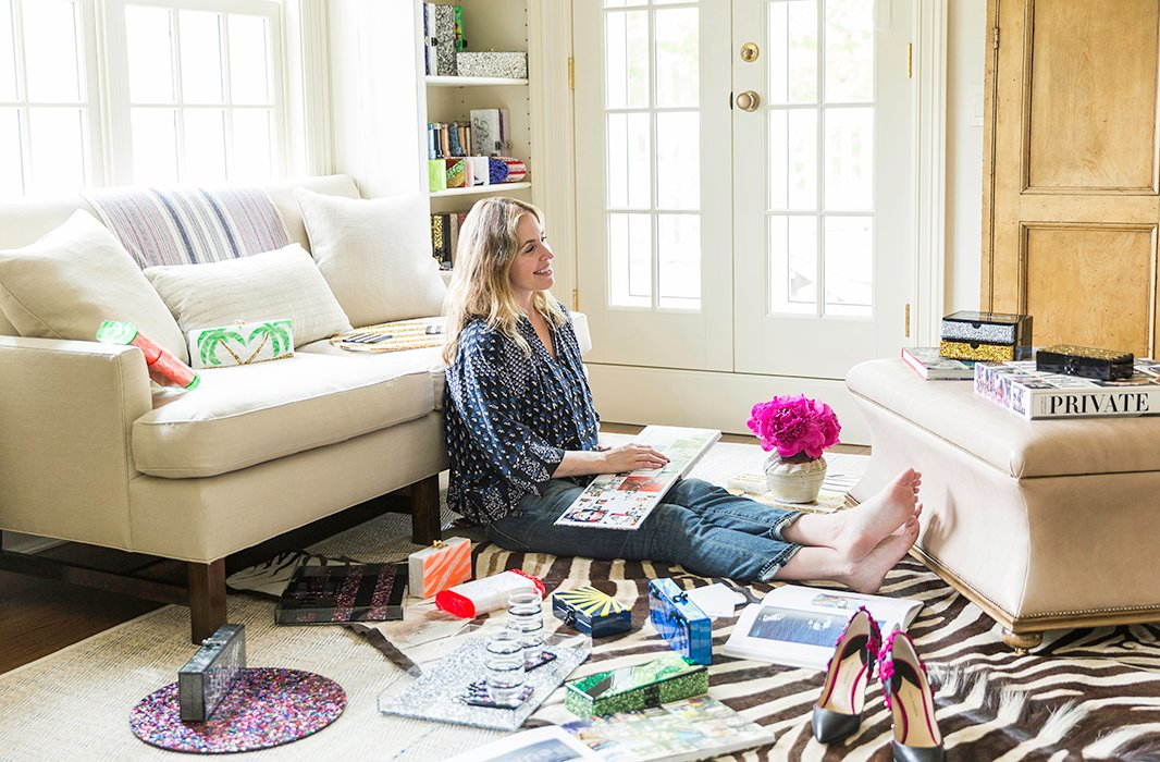 A collection of Edie Parker handbags and trays, which are emblazoned with colorful marbleized swirls and cursive lettering, are sprinkled throughout Brett's home.