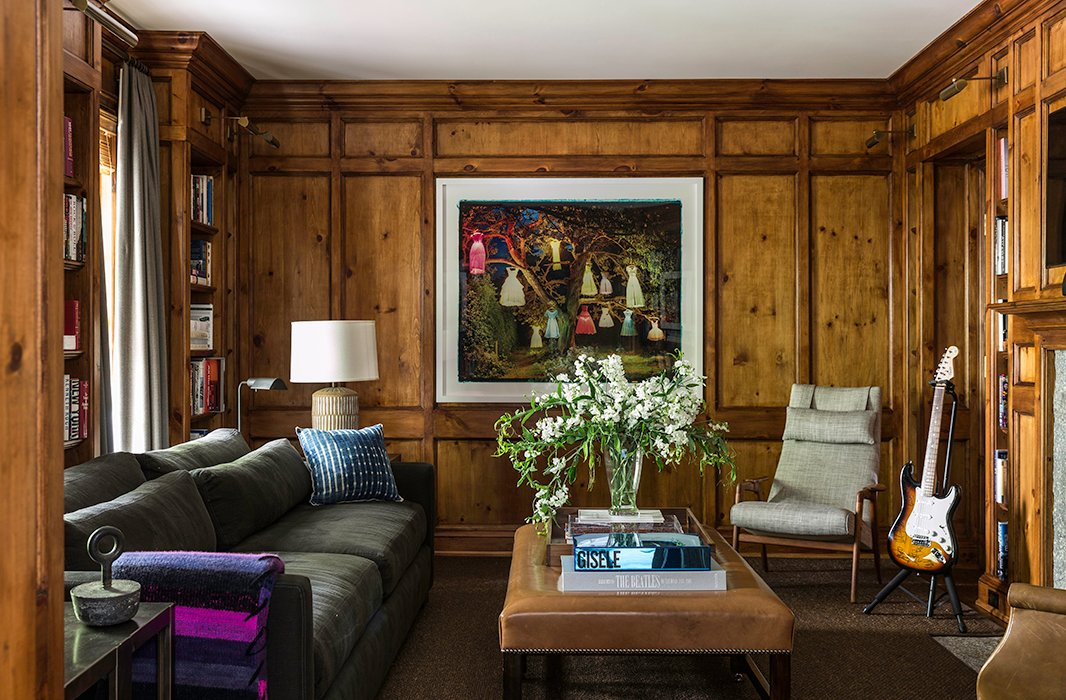 Brett's masculine wood-paneled library is a quiet retreat for those occasions when one needs alone time.