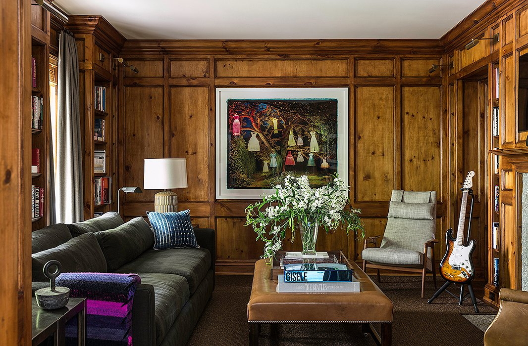 Brett's masculine wood-paneled library is a quiet retreat for those occasions when one needs alone time. Find a similar sofa here.