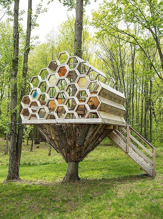 "Brett worked with a local carpenter to construct her ""bee house,"" an elevated home for her bee hives. ""He is amazingly artistic, actually,"" she tells us, ""so when we wanted to build the bee house, he was the one that was like, 'Let's do something a little bit unexpected.'"""