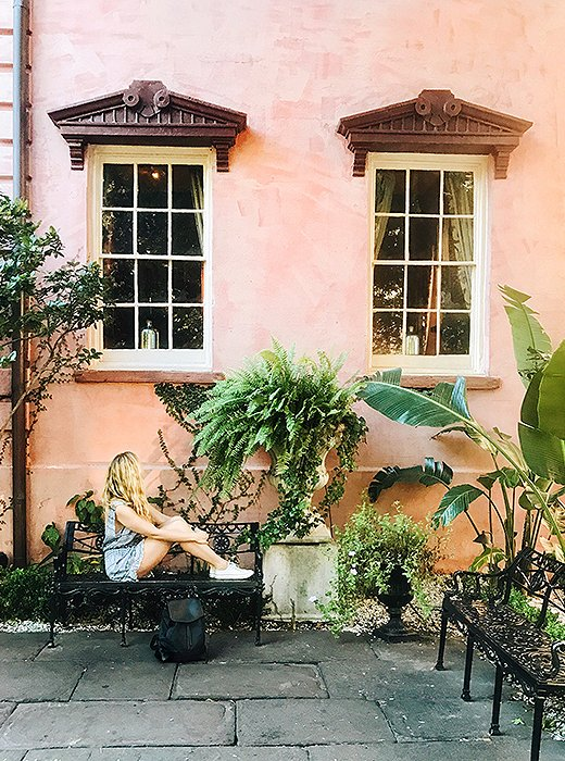 Michelle takes in the scenery outside The Olde Pink House, a favorite Savannah spot for cocktails and small bites. Photo by @livelikeitsthewknd.