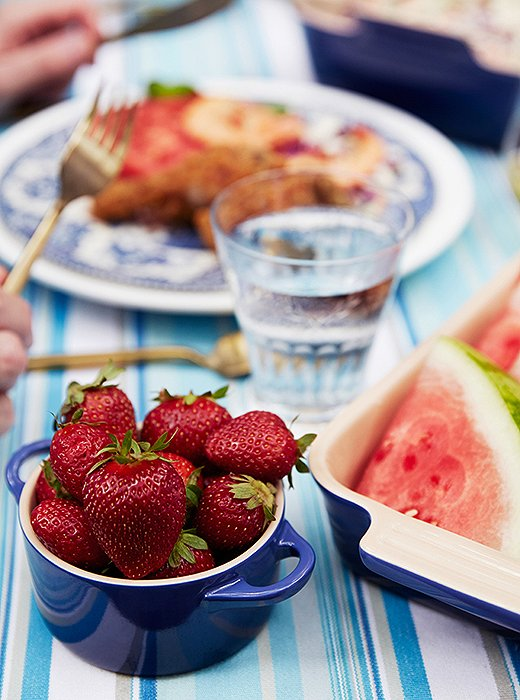 Bowls of strawberries and slices of watermelon made for easy and fresh summer desserts.