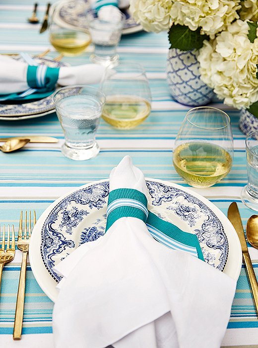 To jazz up her place settings, Guérard tied grosgrain ribbon around her dinner napkins.