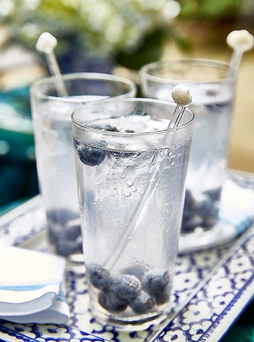 "As a refreshing summer sipper, Guérard served vodka sodas with a splash of grapefruit and fresh blueberries. ""I call it my skinny drink,"" she jokes."