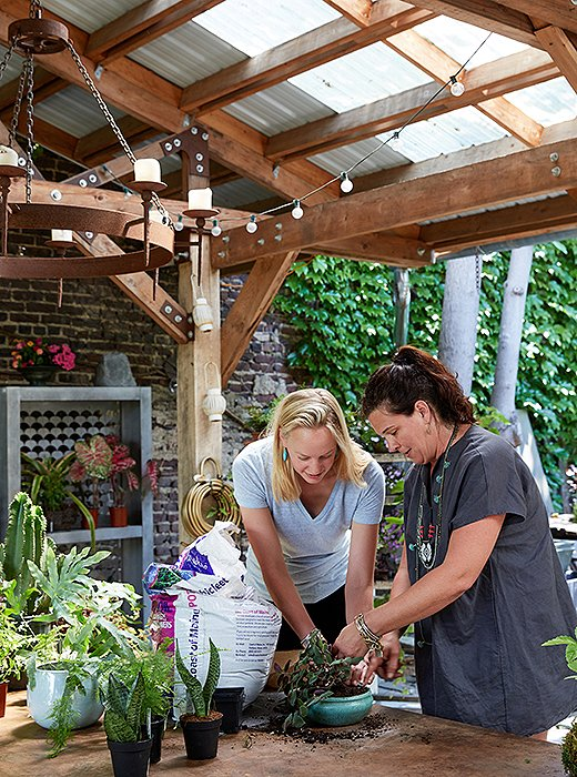 Amanda shows me how to pack potting soil into a pot. Getting your hands dirty is all part of the therapy that gardening—wherever you're doing it—will give.
