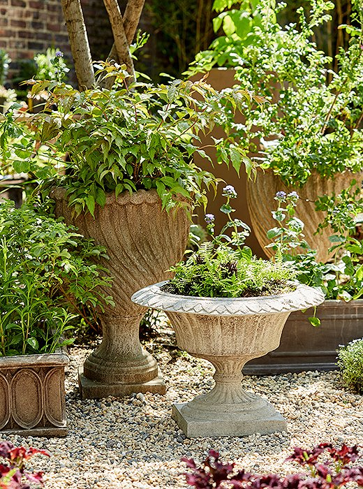 Part of the fun of making an indoor garden lies in breaking the rules on which vessels might typically go outside or in. What's more, delicate pieces like an antique plant stand can be easier to preserve indoors. Wouldn't one of these weathered urns look lovely in a foyer?