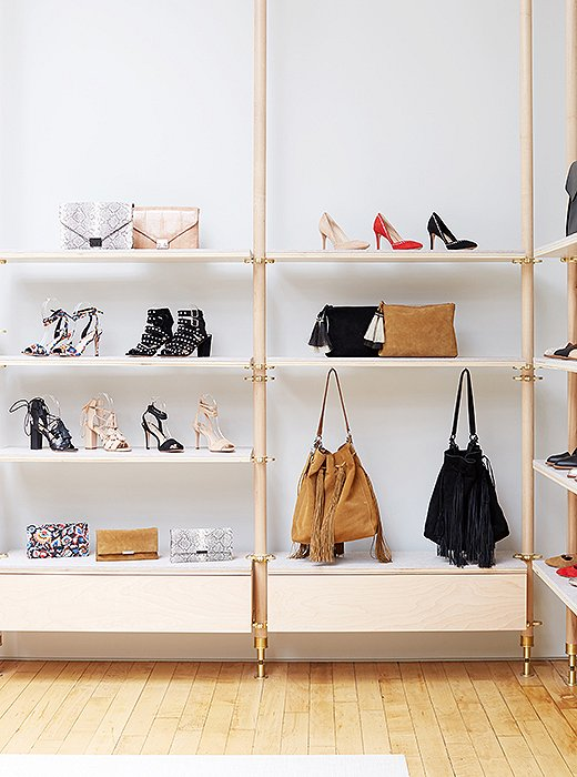 The latest handbags and shoes are on display in the showroom.
