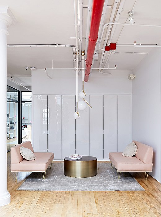 The ceiling fixtures in the sitting area are by Flos Lighting. The bronze coffee table is by Milo Baughman.