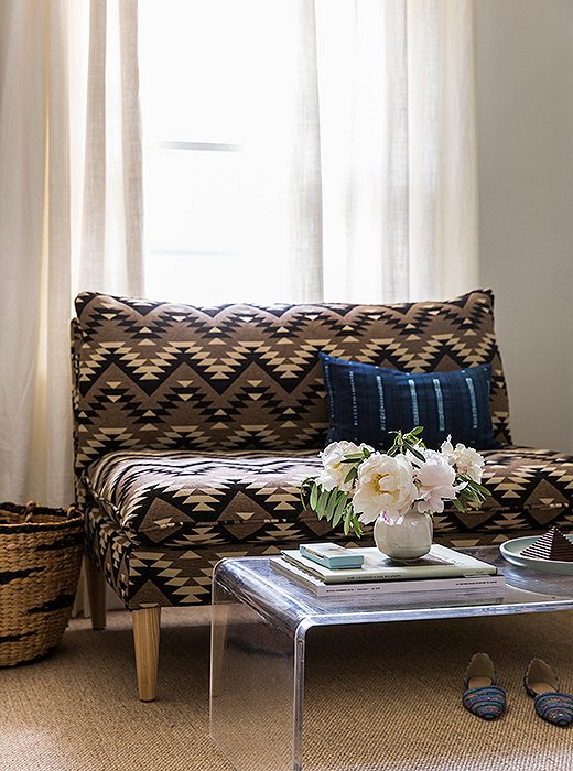 "When choosing fabrics for her line, which includes this tribal-print settee, ""I thought about the classic collections that companies like Ralph Lauren have been reintroducing, with Navajo-inspired textiles,"" Michelle says. ""They're always going to have a place in the home."""