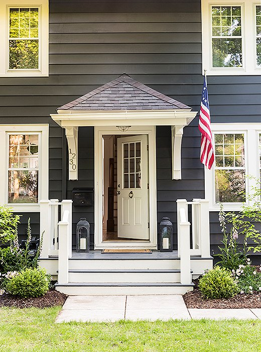 "In order to mask the pediment above her front door, ""which was really large in my opinion and really dark,"" Michelle painted the whole house a dark charcoal color. ""It works like a charm, if I do say so myself."""