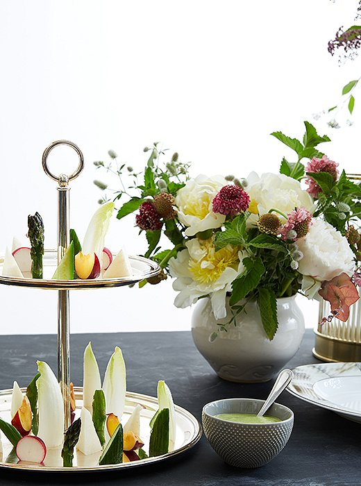 The chef made a dipping sauce for crudités with fresh herbs, lemon, coconut milk, and pumpkin seeds. The polished silver-plated server by Ralph Lauren Home provided refined, timeless appeal.