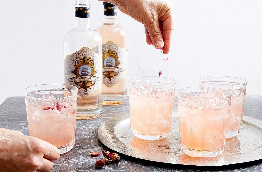 Dried rose petals were sprinkled into Camilla's cocktail as a romantic garnish. The hand-cut, mouth-blown crystal glassware by Ralph Lauren Home was a classic touch.