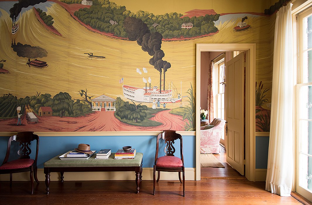 """Color is a good way to take a risk because if you fail, it's easy to fix,"" says Thomas, who chose a bright cobalt hue for the area underneath the parlor wall's whimsical storybook-inspired mural. ""It was fine without it, but we wanted to punch it up, and the blue made it more exciting."""
