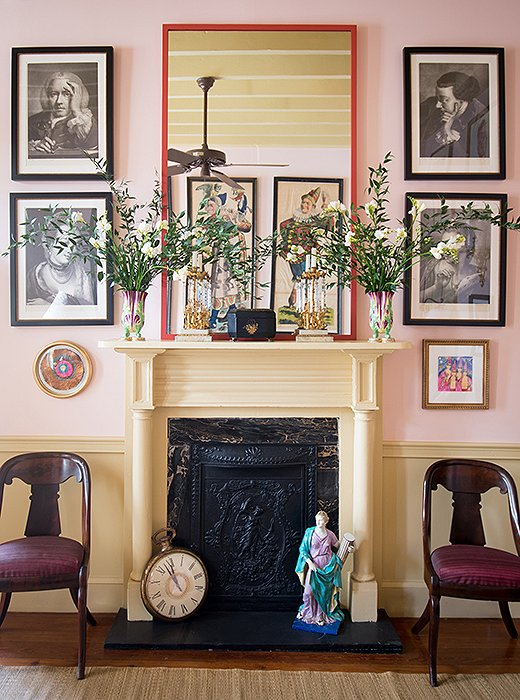 "The handsome living room mantel, framed by Thomas Frye mezzotint prints, makes for a graceful home to a myriad of objects, ranging from a 19th-century sculpture to the oversize clock left over from a ""Father Time"" Mardi Gras costume."