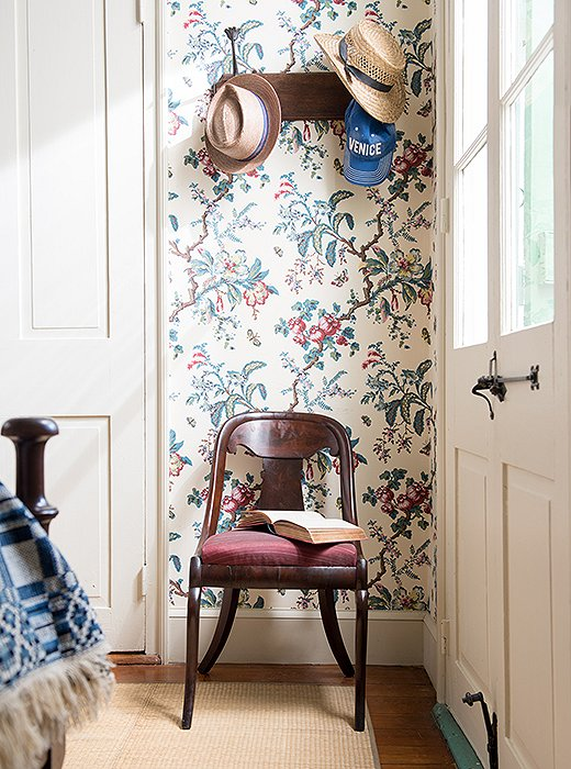 "The Butterfly Chintz wallpaper produced by Adelphi Paper Hangings, a company specializing in historically accurate custom papers, is ""a hand-blocked copy of an antique French paper in the collection at Colonial Williamsburg,"" says Thomas. He used it for a home he restored in Virginia before covering his own bedroom with it. ""I remember saying to my colleague, 'Can I get away with this? Is this oppressive?' It's a good example of taking a risk."""
