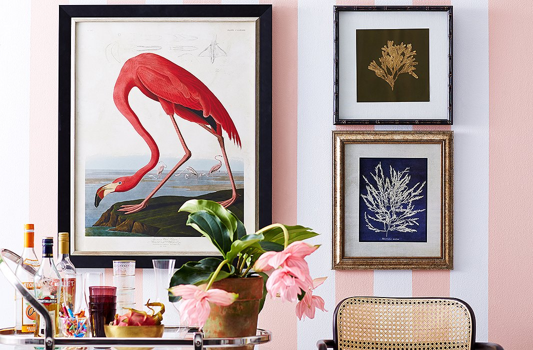 """Diana Vreeland famously declared pink """"the navy blue of India.""""When used as a background for coastal art, it calls to mind Palm Beach.The flamingo print above is a reproduction of an Audubon illustration. Photo by Tony Vu."""