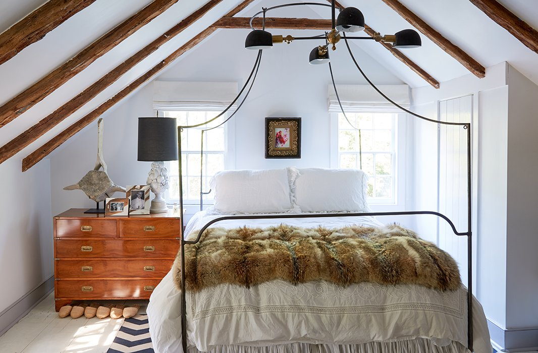 """I have an easier time keeping a neutral palette as a canvas,"" Jennifer says. ""The house really wants white walls… It's so tiny and has all of that ancient woodwork everywhere and beams in the ceiling. It needs to breathe."""