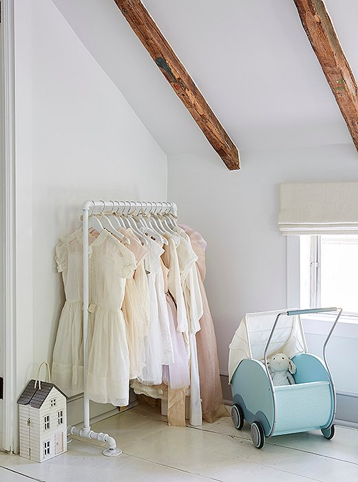 Tallulah's collection of pastel dresses is picture-perfect for the soft palette of her bedroom.