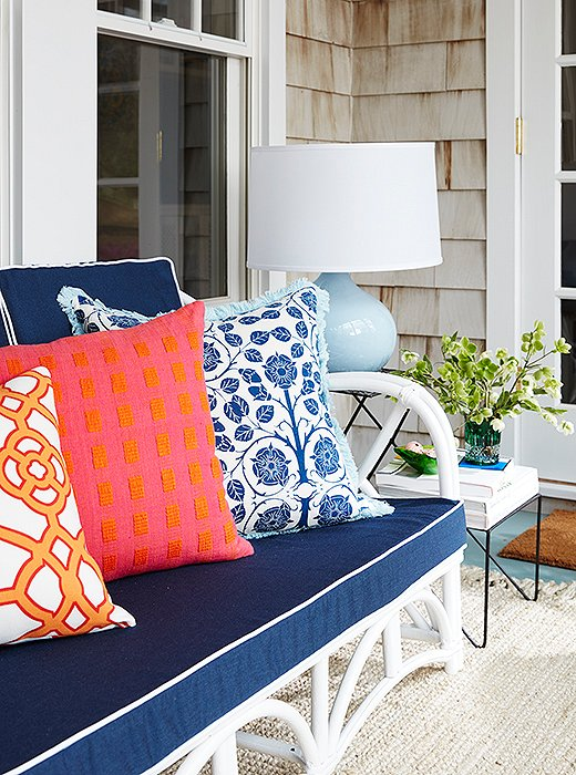 """I feel like patterns and the darker colors will let you get away with more staining, which happens a lot outside,"" Estee says of her choice of navy upholstery. When decorating outdoors, ""I recommend using more outdoor fabrics and not-so-precious, sturdier fabrics."""