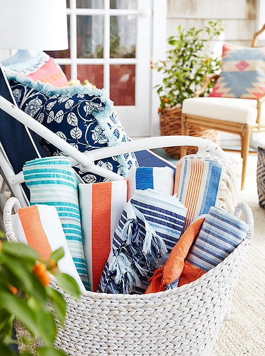 Estee keeps a collection of striped beach blankets handy for the pool and the beach.