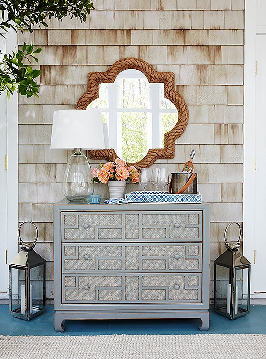 "Estee decided to use a gray dresser as a bar to house her summer entertaining essentials. ""All the drawers  are stocked for nights and parties,"" she says."
