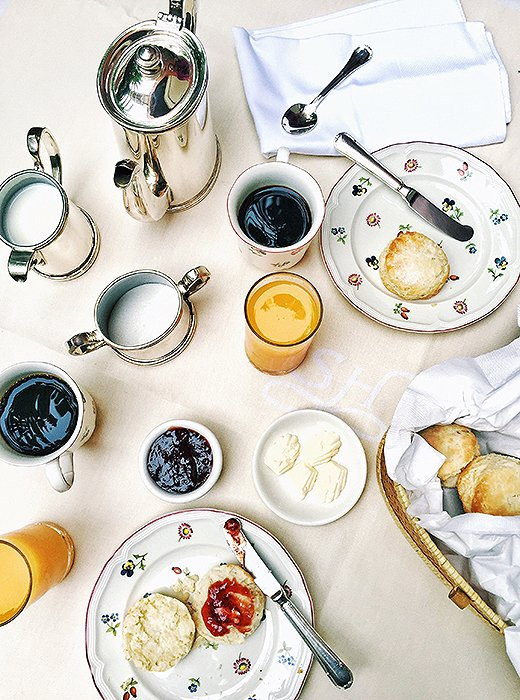 Perfect mornings at the Soniat House start with fresh-baked buttermilk biscuits and coffee poured from an antique silver service. Photo by Kelly Lack.
