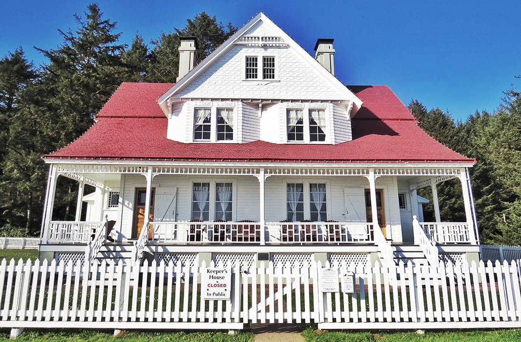 The Queen Anne-style keeper's home, also a homey bed-and-breakfast, adjacent the Heceta Head Lighthouse. Photo by Kelly Lack.