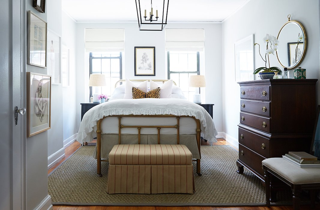 "Reconfiguring the bedroom layout gave the space depth and a strong style statement. ""Before, you couldn't see the amazing bed through the clutter. I wanted to give Cole's great pieces a stage to shine,"" says Alex, who dressed the room in neutral shades: beige, white, and black."