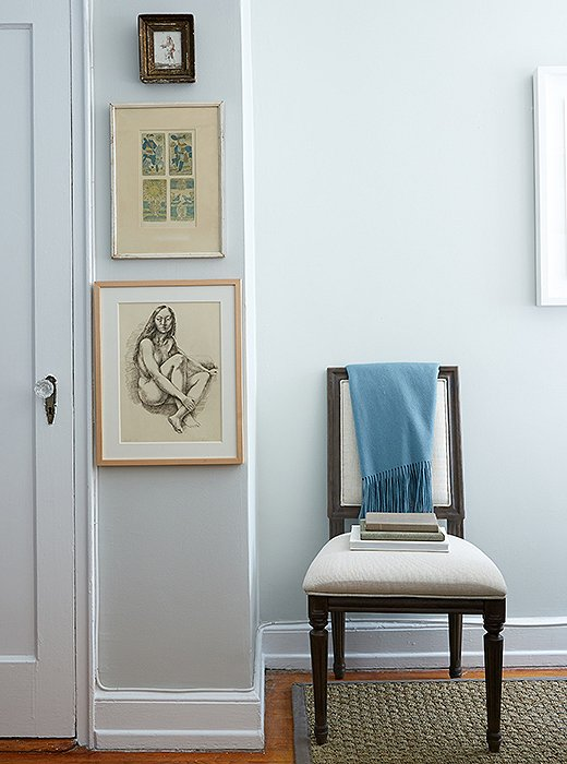 A sliver of wall becomes a pixie gallery. The charcoal drawing is by Virginia artist Lincoln Perry. The graceful Swedish-style chair plays three roles: office chair, guest seating, and solo reading spot.