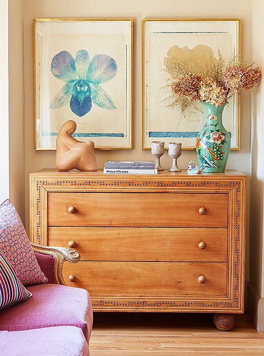 """I love the dresser with studs and the big ball feet,"" Michelle gushes over the antique find. ""It makes me want to buy plain dressers and put nail heads on them."""