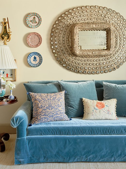 The plates framing jaymeres peacock mirror are made by interior designer penny morrison aren