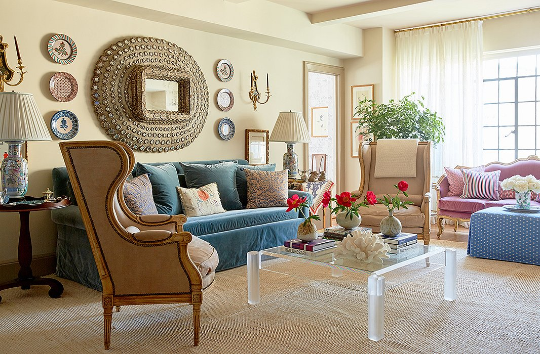 """Once I 'got' her, and I found the right inspiration—a little bit Lee Radziwill and a little bit Renzo Mongiardino—it was very easy,"" Michelle tells us. Much of the living room is inspired by a room created by the Italian design master Mongiardino. His design ""has a mirror similar to her Moroccan mirror that she already had. Then, ottomans that are teal blue, and a lot of pink. That was my color inspiration for the room,"" Michelle says. A set of plates frames the room's mirrors."