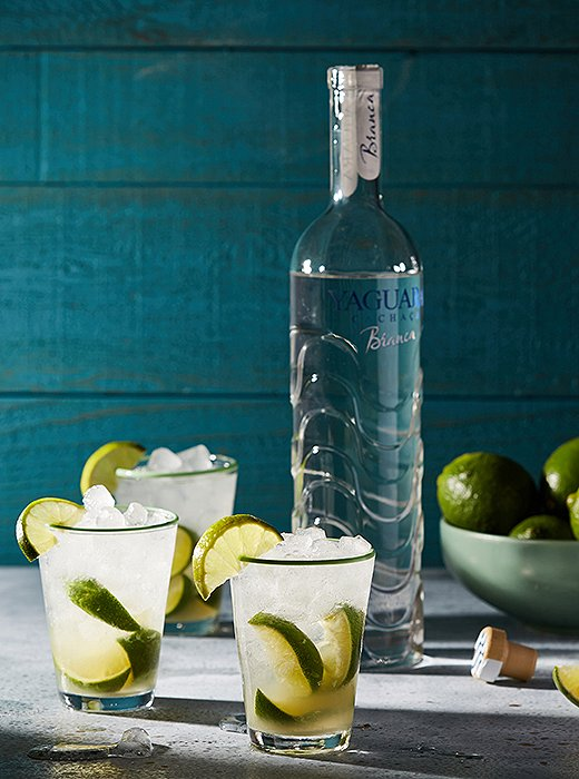 Aclassiccaipirinha is perfect forstaving off the summer heat. Our take uses Yaguara cachaça and lots of lime.
