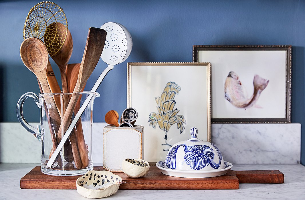 A few small paintings and ceramics add charm to Kate's kitchen.
