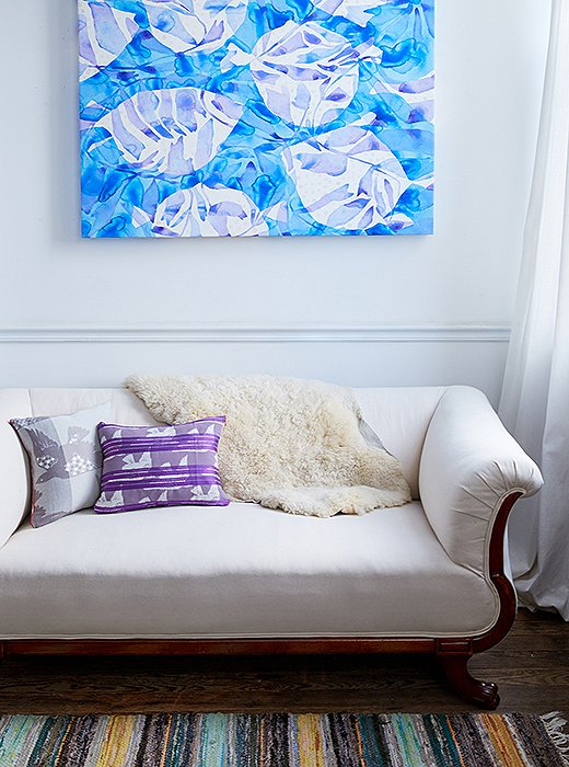 An antique settee provides a cozy place to hang when Kate takes breaks from painting.