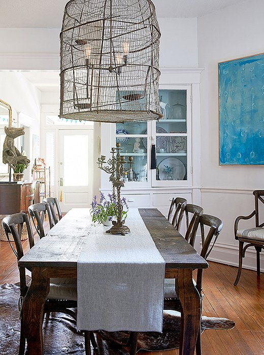 "The blue painting in Kate's dining room is by artist friend Addie Chapin. Her art collection consists largely of ""pieces my husband and I found together on a trip, pieces friends have made, or gifts to one another,"" she says. ""We love to give art to each other to mark special moments in life."""