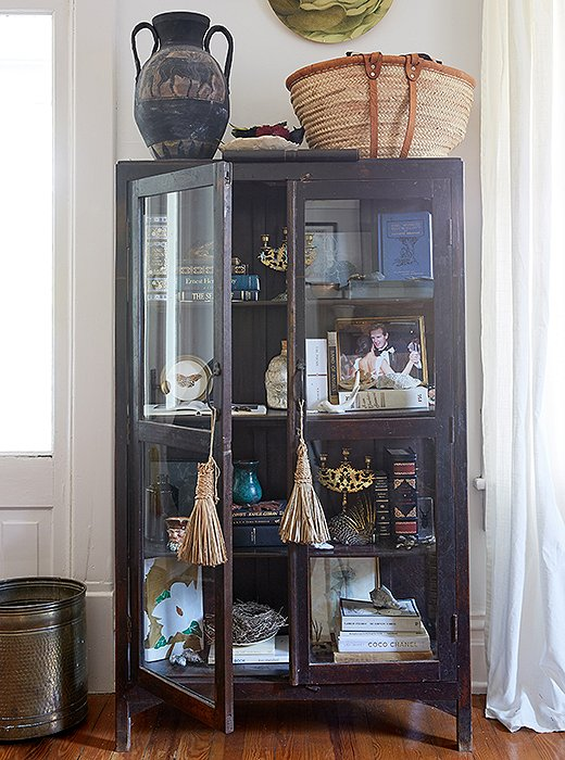 A pair of silk tassels add a bit of polish to an industrial cabinet.