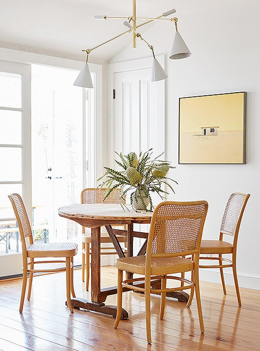"""The vintage Hoffmann dining chairs are so classic and chic. I love them,"" Alex says. Juxtaposed with the French barn table, they ""bring more texture and character to the space, without a ton of color."""