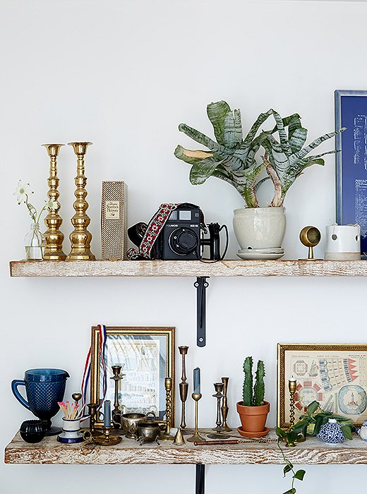 "Along one wall of the dining area are reclaimed-wood shelves—a transplant from their San Francisco pad. ""They have such beautiful wear on them,"" says Rosie. ""I could not bear to give them up."""